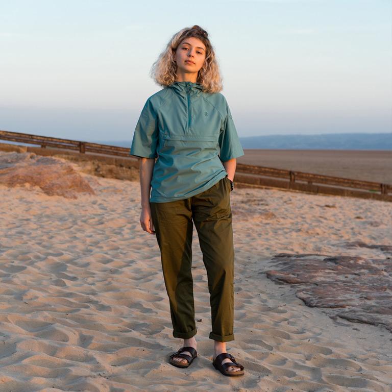 Girl on beach wearing Fjallraven Battenwear and Birkenstock